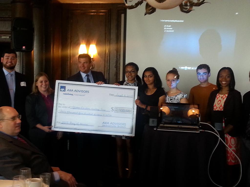 VP of Axa Nathan Moore presents check to Julia Landon School